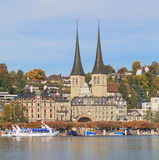 Lucerne, Autumn. Lucerne, Switzerland. Autumn cityscape with Church of St. Leodegar towers Royalty Free Stock Image