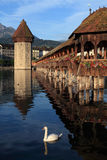 Lucerne Chapel bridge in Switzerland. The Chapel Bridge and Lake Lucerne, in the city of Lucerne, Switzerland.  Photo taken early in the morning as the sun Stock Images