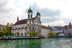 Lucerne, Jesuit church by the Reuss river Royalty Free Stock Photos