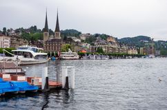 Lucerne lake side view marina bay with ships  old town in the background overcast day stock photo