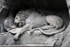 Lucerne lion statue. Stone statue depicting a lion in Lucerne Switzerland Royalty Free Stock Photos