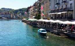 Lucerne by the river. Lucerne's daylife by river Reuss Royalty Free Stock Photo