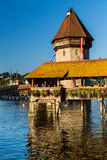 LUCERNE, SWITZERLAND - AUGUST 2: Views of the famous bridge Kape. Llbruecke on late afternoon in Lucerne on August 2, 2015. Lucerne is a famous tourist Royalty Free Stock Image