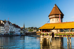 LUCERNE, SWITZERLAND - AUGUST 2: Views of the famous bridge Kape. Llbruecke on late afternoon in Lucerne on August 2, 2015. Lucerne is a famous tourist Royalty Free Stock Photos