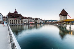 LUCERNE, SWITZERLAND - AUGUST 2: Views of the famous bridge Kape. Llbruecke at sunset in Lucerne on August 2, 2015. Lucerne is a famous tourist destination in Royalty Free Stock Photo