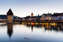 LUCERNE, SWITZERLAND - AUGUST 2: Views of the famous bridge Kape. Llbruecke at sunset in Lucerne on August 2, 2015. Lucerne is a famous tourist destination in Stock Photos