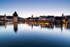 LUCERNE, SWITZERLAND - AUGUST 2: Views of the famous bridge Kape. Llbruecke at sunset in Lucerne on August 2, 2015. Lucerne is a famous tourist destination in Stock Image