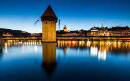 LUCERNE, SWITZERLAND - AUGUST 2: Views of the famous bridge Kape. Llbruecke at sunset in Lucerne on August 2, 2015. Lucerne is a famous tourist destination in Stock Photo