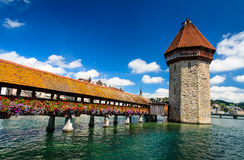 Lucerne, Switzerland. Chapel Bridge and Water Tower is a covered wooden footbridge across the Reuss River in city Lucerne in central Switzerland Royalty Free Stock Photo