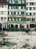 Lucerne, Switzerland: Cyclist, pedestrians in Old Town square Mühlenplatz Royalty Free Stock Photo