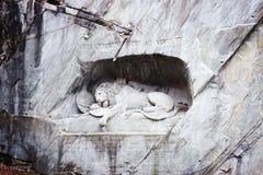 Dying Lion monument Lucerne Switzerland. Lucerne, Switzerland - January 04, 2014: Dying Lion monument, a sculpture in Lucerne (Switzerland) carved in the rock to stock photos