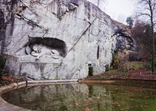 Dying Lion monument in Lucerne Switzerland. Lucerne, Switzerland - January 04, 2014: Dying Lion monument, a sculpture at Lucerne (Switzerland) carved in the rock stock photo