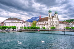 Lucerne, Switzerland. Jesuite church and town theater over the Reus river in the center of Lucerne, Switzerland royalty free stock photo