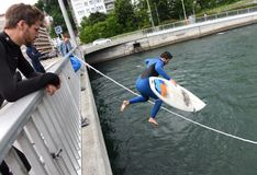 Free Lucerne, Switzerland - June 04, 2017: Surfer Jumps From The Bridge In Reuss River In Lucerne, Switzerland. Royalty Free Stock Photo - 112345645
