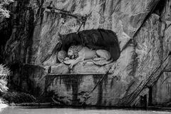 LUCERNE, SWITZERLAND - JUNE 3, 2017: The black and white photo of Lowendenkmal, the Lion Monument, which is the dying lion statue Royalty Free Stock Photos