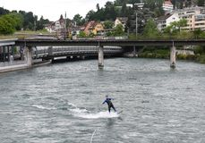 Lucerne, Switzerland - June 04, 2017: Surfer on Reuss River in L stock photography
