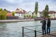Street view with fishermen, Luzerne Stock Photos