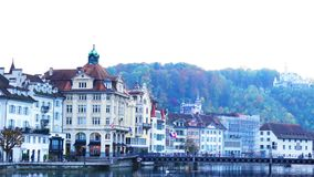 View of building along the Reuss River in the evening. Lucerne, Switzerland - October 21, 2015 : View of building along the Reuss River in the evening, LUCERNE stock footage