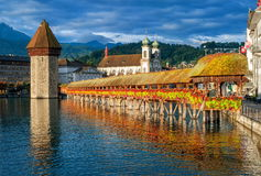 Lucerne, Switzerland. View to the Water Tower (Wasserturm) and wooden Chapel Bridge (Kapelbrücke) in Lucerne, Switzerland Royalty Free Stock Photography