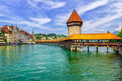 Lucerne, Switzerland. View to the Water Tower (Wasserturm) and wooden Chapel Bridge (Kapelbrücke) in Lucerne, Switzerland stock photos
