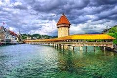 Lucerne, Switzerland. View to the Water Tower (Wasserturm) and wooden Chapel Bridge (Kapelbrücke) in Lucerne, Switzerland royalty free stock photography