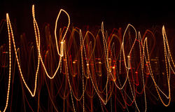 Luces abstractas de velas en el movimiento Imágenes de archivo libres de regalías