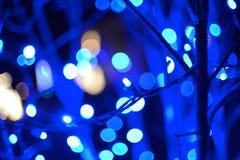 Luces abstractas del día de fiesta de las luces de la Navidad Foto de archivo