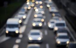 Luces abstractas del tráfico y del coche de la falta de definición Fotos de archivo