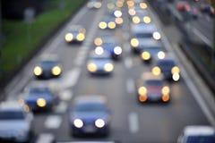 Luces abstractas del tráfico y del coche de la falta de definición Imagen de archivo libre de regalías