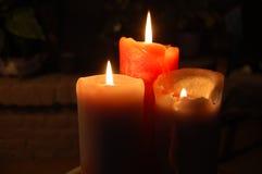 Luces anaranjadas de la vela Fotos de archivo libres de regalías