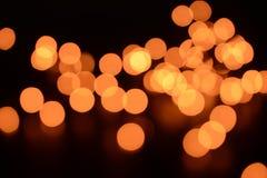 Luces anaranjadas en el fondo imagenes de archivo