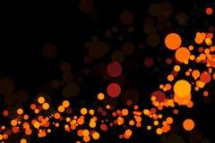 Luces anaranjadas en un fondo negro Imágenes de archivo libres de regalías