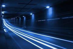 Luces azules dentro del túnel Imágenes de archivo libres de regalías