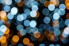 Luces blancas, azules y anaranjadas del fondo abstracto Fotos de archivo libres de regalías