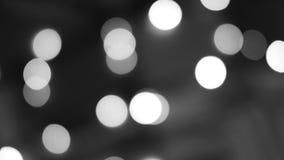 Luces blancos y negros borrosas Fondo festivo Defocused del bokeh que brilla metrajes