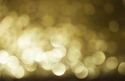 Luces borrosas con el fondo de oro del efecto del bokeh Fotos de archivo libres de regalías