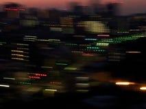Luces borrosas de la ciudad en la noche Fotos de archivo libres de regalías