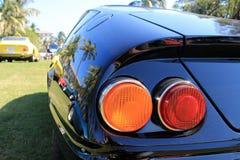 Luces clásicas de la cola del coche de deportes Imagen de archivo libre de regalías