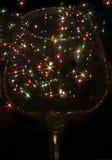 Luces coloreadas bajo la forma de estrella seis-irradiada en el vidrio Fotografía de archivo