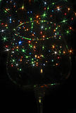Luces coloreadas bajo la forma de estrella seis-irradiada en el vidrio Imagen de archivo libre de regalías
