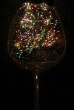 Luces coloreadas bajo la forma de estrella seis-irradiada en el vidrio Fotos de archivo libres de regalías