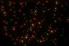 Luces coloreadas bajo la forma de estrellas seis-irradiadas Imagenes de archivo