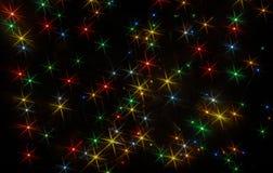 Luces coloreadas bajo la forma de estrellas seis-irradiadas foto de archivo