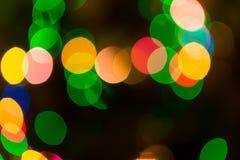 Luces coloridas del bokeh en fondo negro Imagen de archivo