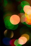 Luces coloridas del bokeh en fondo negro Imagenes de archivo
