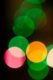Luces coloridas del bokeh en fondo negro Fotografía de archivo libre de regalías