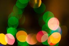 Luces coloridas del bokeh en fondo negro Imagen de archivo libre de regalías