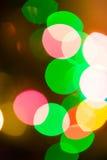 Luces coloridas del bokeh en fondo negro Foto de archivo libre de regalías