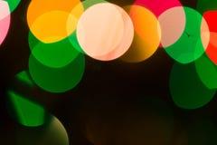 Luces coloridas del bokeh en fondo negro Fotografía de archivo