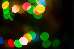 Luces coloridas del bokeh en fondo negro Fotos de archivo